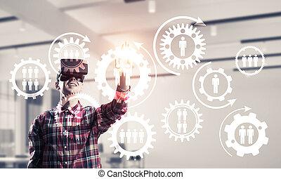Guy wearing checked shirt and virtual mask demonstrating...