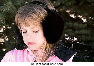 Ear Muffs - Young girl wearing black fox ear muffs.