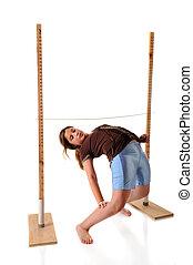 Limbo - A preteen girl playing limbo. She's bending...