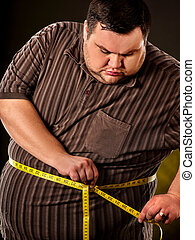 Man belly fat with tape measure weight loss around body. -...
