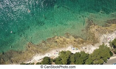 Aerial top down view of a rocky beach of the Adriatic sea....