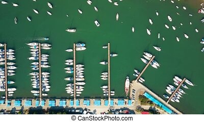 Aerial top down view of parked boats, motorboats and...