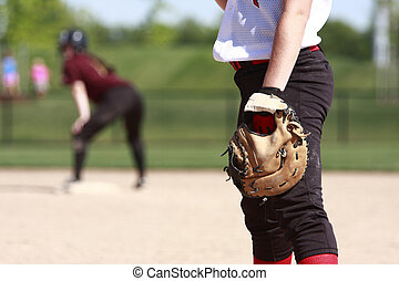 Softball players on the field.