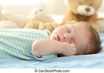 Cute baby sleeping on a bed - Portrait of a cute baby...