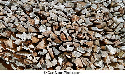 a pile of chopped log ready to be used at the fire place in winter at Austria