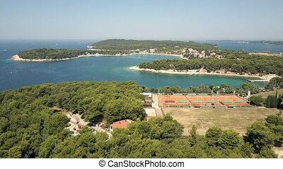 Aerial view of tennis courts on the shore of the Adriatic...