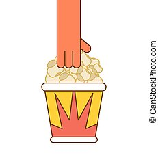 Popcorn and hand. Paper box popped corn
