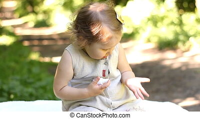 A little girl uses a remedy against mosquito bites and ticks...