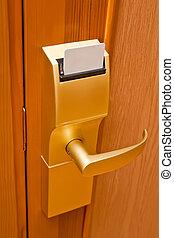Door lock key - Door lock in the hotel room.
