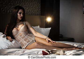 Lingerie in bed - Beautiful lady in sexy lingerie poses in...