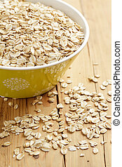 oatmeal on wooden table - photo shot of oatmeal on wooden...