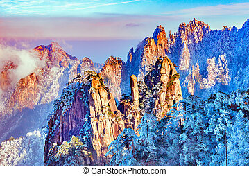 Colorful peaks of Huangshan National park. - Sunset above...