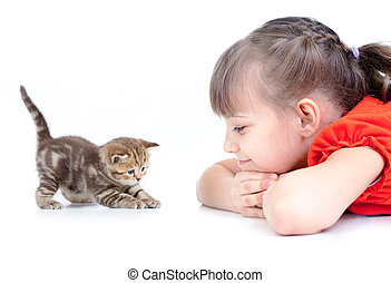 Happy kid looking on playing kitten isolated