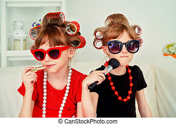 kindergarten at fashion - Two funny little girls with...