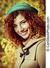 green hat girl - Smiling red haired girl enjoys a sunny...