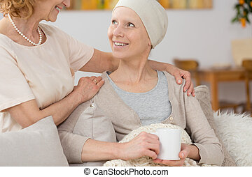 Time with friend - Smiling woman suffering from cancer...