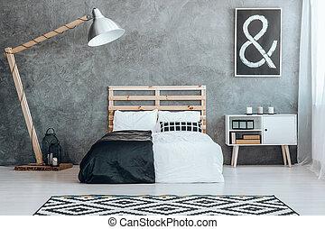 Concrete wall in simple dark room