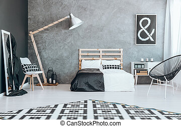 Black and white coverlet - Wooden bed with black and white...