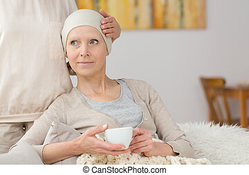 Sick woman and tea - Sick woman suffering from cancer...