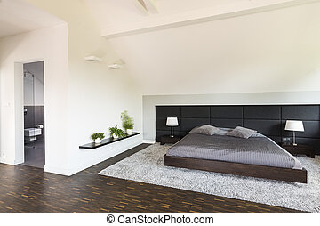 Light spacious bedroom with white walls