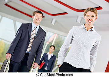 Business people - Confident woman standing in front of...