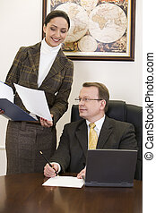 Secretary and boss - Beautiful woman is showing an official...
