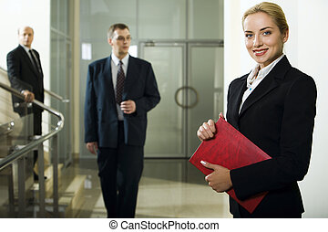 Business lady - Smart beautiful businesswoman with red case...