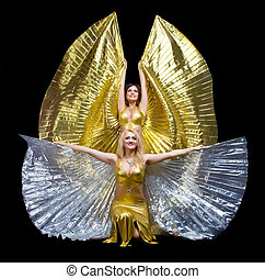 Two woman dance with wings