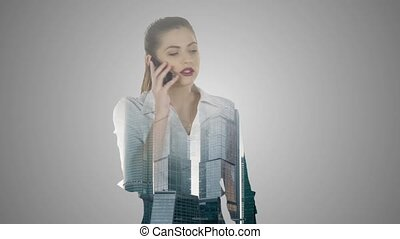Business woman speaks by mobile phone double exposure over...