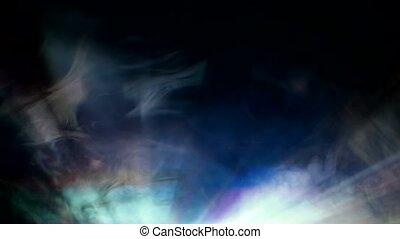 Dazzling of light from projector in fog. Rays of light -...