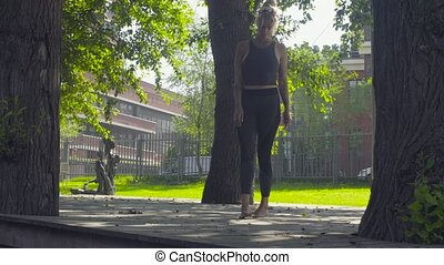 A young woman walking barefoot on wooden flooring, and then...