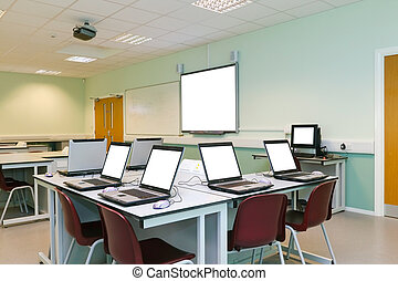 IT classroom blank computer screens - An IT classroom...