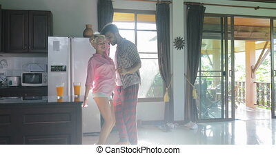 Couple Dance In Kitchen Happy, Young Cheerful Man And Woman...