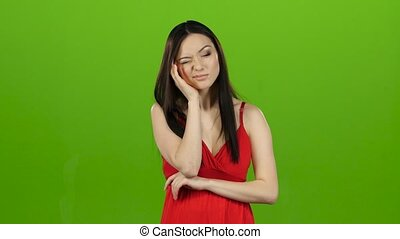 Girl has a headache, she is suffering from migraines. Green...