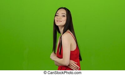 Girl posing for cameras, this is her work. Green screen -...