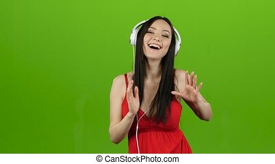 Girl listens to cheerful and energetic music through...