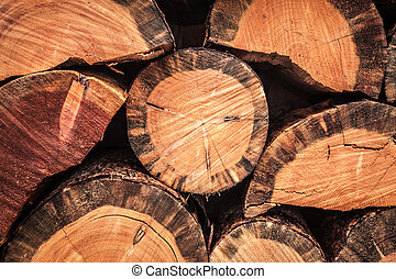Stack of chopped firewood background - A woodpile of stacked...