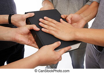 Holding Holy Bible and taking promises - Group of people...