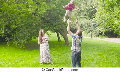 Dad throwing and catching his baby
