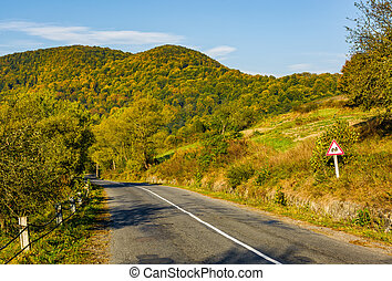 asphalt road with limitation sign in mountainous...