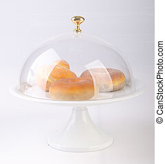cake stand with cakes on a backgeound. - cake stand with...