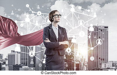 Concept of power and sucess with businesswoman superhero in...