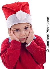 Boy as Santa Claus is worried