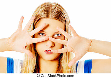 Woman covering her face with hands.