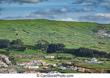 Farm fields with houses in the Terceira island in Azores -...