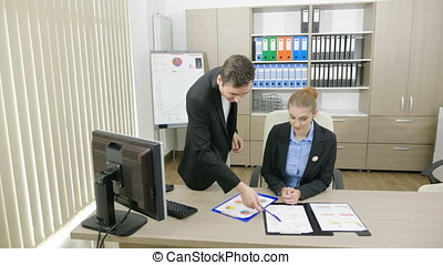 Business persons at a desk office talking and analyzing...