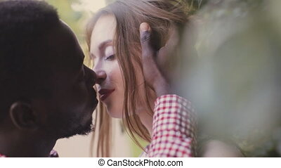 kissing mixed race couple close up - lover kissing mixed...