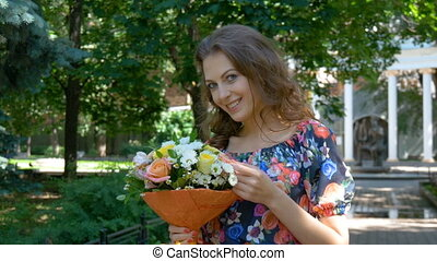 Young beautiful woman with bouquet of flowers - Young woman...