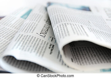 Financial newspapers, low depth of field, focus on the word...