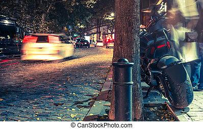 motorbike on a road at night on illuminated street